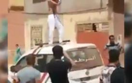 فيديو. مشرمل عامر دمايات طالع فوق سيارة البوليس كايحيح