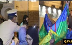 """فيديو . عنصر أمن يمنع شخصاً من رفع العلم الأمازيغي بمهرجان """"تويزا"""" بطنجة"""