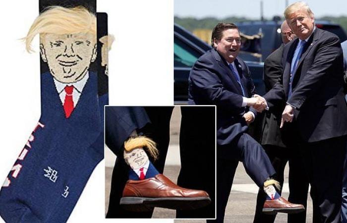 """حاكم ولاية أمريكية يستقبل ترامب بـ""""تقاشر"""" عليها صورة وجهه !"""